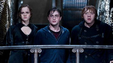 Hermione Granger, Harry Potter and Ron Weasley portrayed by Emma Watson, Daniel Radcliffe and Rupert Grint in <i>Harry Potter and the Deathly Hallows: Part II</i>.