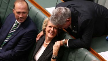MP Ken Wyatt and Foreign Minister Julie Bishop talk prior to Prime Minister Tony Abbott delivering the Closing the Gap report.