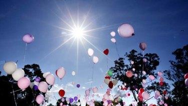 Vigil ...  balloons are released near Kiesha's home.