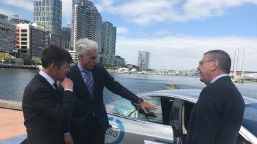 Roads Minister Luke Donnellan, Transurban CEO, Scott Charlton,  and VicRoads boss John Merritt check out a driverless car.
