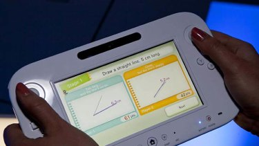 Nintendo's next video game console, the Wii U, is demostrated with the Measure Up game at the Nintendo booth at the 2011 Electronic Entertainment Expo in Los Angeles.