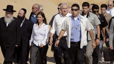 Looming poll ... Benjamin Netanyahu, centre, visits Ashdod, near the Gaza border, last week.