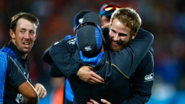 Kane Williamson and Luke Ronchi celebrate after their semi final win against South Africa.