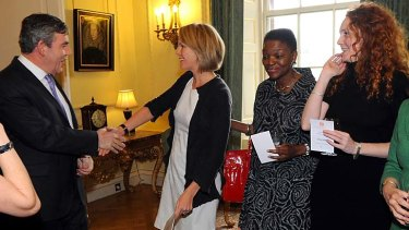 All smiles … then prime minister Gordon Brown meets Elisabeth Murdoch and Rebekah Brooks in 2008.