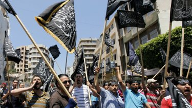 Lebanese Sunni Muslims Islamists protest in Beirut, after the killing of at least 108 people in the Syrian town of Houla.