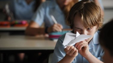 Folding future: Ed Oxenbould as Dylan, an 11-year-old who discovers he has a knack with the folding stuff, in <i>Paper Planes</i>.