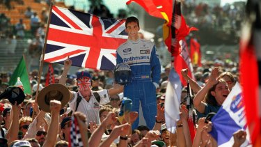 Fans holds up a cardboard cut out of Britain's Damon Hill, who won the 1996 Australian Grand Prix in Melbourne.