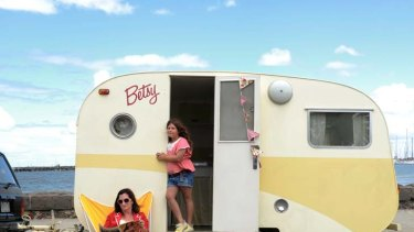Home away from home ... Felicity Young and her eight-year-old daughter, Zara Tallulah, relax with Betsy, a 54-year-old Skyline Junior Bondwood caravan.