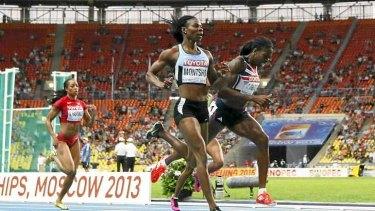 Christine Ohuruogu (R) wins the gold medal.