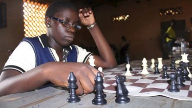 Food for the brain: Chess champion Phiona Mutesi plans her next move.