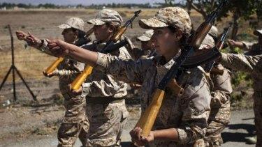 Quick march: Female Peshmerga recruits in Sulaimaniya.