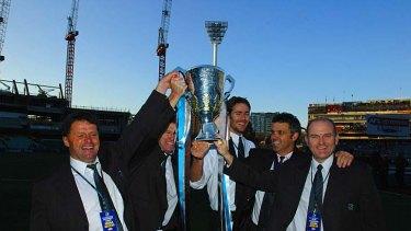 Dean Bailey, far right and coach Mark Williamscelebrate the 2004 grand final win.