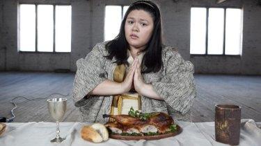 Chicken wing and prayer: Nakkiah Lui.