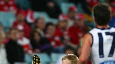 Geelong's Steve Johnson reels in a one-handed mark last night.