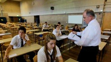 Feeling privileged ... Doriana Szkudlarek prepares as Terry Vallis hands out exam papers.