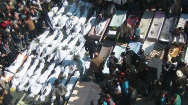 Bloodiest day ... mourners gather around the coffins of those killed in government attacks in the Khaldiyeh neighbourhood in Homs province, central Syria, on Saturday.