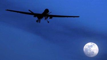 An unmanned US Predator drone flies over Kandahar Air Field.