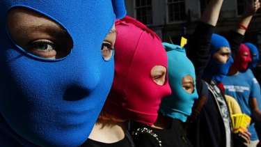 World is watching ... masked protesters take part in a flash mob demonstration in Edinburgh, Scotland, in support of the Russian punk group Pussy Riot.