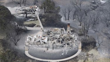 This aerial photograph shows the wreckage of a large home at  Possum Kingdom Lake.