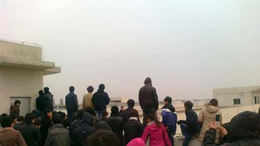 Some Foxconn workers were found allegedly standing on a roof's ledge.
