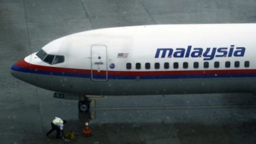 Safety considerations: A ground staff works near a Malaysia Airlines aircraft at the Kuala Lumpur International Airport this week.