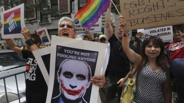 Rainbow rage: Demonstrators outside the Russian consulate in New York protest against Russia's homophobic legislation.