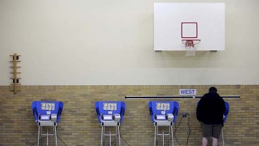 Every vote counts ... a man casts his ballot using an electronic voting machine at an elementary school in Bowling Green, Ohio.