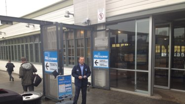 Stiff competition: Former prime minister Tony Abbott chasing the commuter vote at Manly wharf.