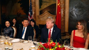 President Donald Trump and Chinese President Xi Jinping, with their wives, first lady Melania Trump and Chinese first lady Peng Liyuan are seated during a dinner at Mar-a-Lago.