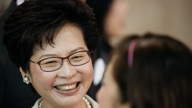 Hong Kong's new chief executive and former chief secretary Carrie Lam outside a polling station for the chief executive election on Sunday.`