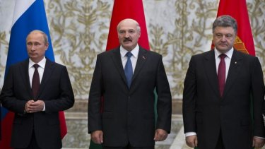 Russian President Vladimir Putin, left, Belarusian President Alexander Lukashenko, centre, and Ukrainian President Petro Poroshenko, this week held 'positive' talks in Minsk, Belarus despite the Ukraine conflict raging on.