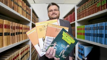 Lawyer and children's author David Downie with some of the titles he's written.