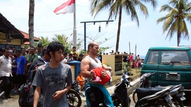 Relief ... Hamid Ranjbarian swam with his daughter for six hours from the capsized vessel.