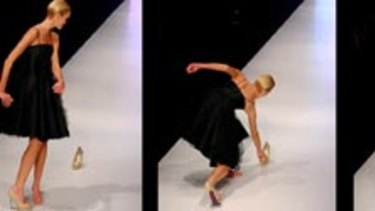 If the show fits (above) a model realises she's strutting sans stiletto before retrieving it to a round of applause from the audience.