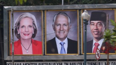 Prime Minister Malcolm Turnbull and his wife Lucy on a billboard with Indonesian President Joko Widodo near the Presidential Palace in Jakarta, Indonesia on Thursday.