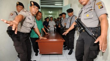 A coffin carrying the body of one of five terror suspects who were shot dead in Bali.
