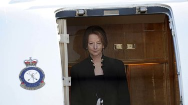 Trips to Tasmania: Former prime minister Julia Gillard disembarking an Air Force jet.