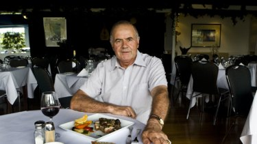 Theo Papoulias with the roast lamb which has been served at Hellenic Club in Sydney since 1959.
