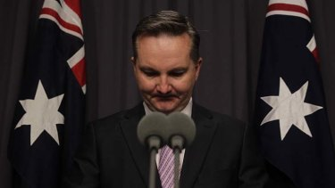 Chris Bowen resigns as a minister during a press conference at Parliament House.