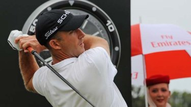 Geoff Ogilvy plays a tee shot during the third round of the Australian Open in Sydney.