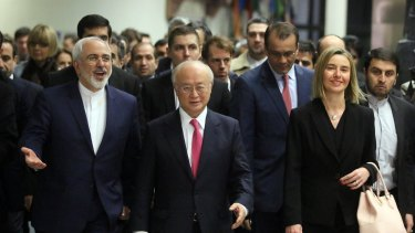 Iranian Foreign Minister Mohammad Javad Zarif, left, with International Atomic Energy Agency chief Yukiya Amano and European Union High Representative Federica Mogherini, right, arrive at the agency's HQ in Vienna in January 2016.