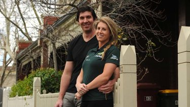 Happy tidings: Kath Macleod and partner Marcus Wright are expecting their first child.