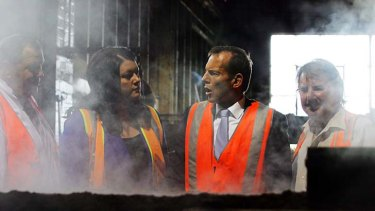 ''I am not in the business of ignoring a big audience'' ... Tony Abbott, right, with the MP for Paterson, Bob Baldwin, and Newcastle Liberal Party candidate Jaimie Abbott, during a visit to the Weathertex factory north of Newcastle yesterday.