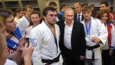 Russian President Vladimir Putin, centre right, poses for a photo with athletes while attending the Judo World Cup in the city of Chelyabinsk in Siberia, Russia.