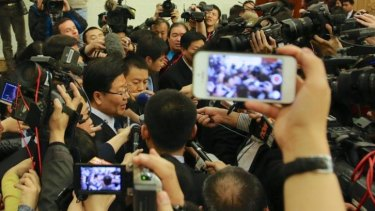 Huge interest ... Chinese Communist Party leader of Xinjiang, Zhang Chunxian, is met by a media scrum after he defended the government's hard-line policies in the country's far west.