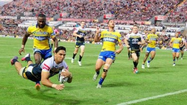 Jump for joy: Curtis Rona of the Cowboys scores against the Eels.