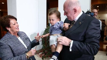 His Excellency General the Honourable Sir Peter Cosgrove AK MC (Retd) the Governor-General of the Commonwealth of Australia, with his wife Lynne and their 18-month-old grandson Max, during a reception in the Members' Hall. Photo: Alex Ellinghausen