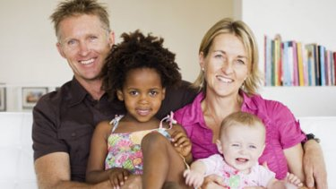 Success story...Paul and Kylie Govers with their daughters Mimi and Kendi.