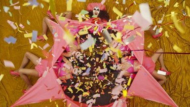 Surpise: The outfit explodes and cannisters filled with confetti are fired.