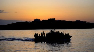 Hope floats ... a boat carrying Tunisian migrants enters the Italian port of Lampedusa.